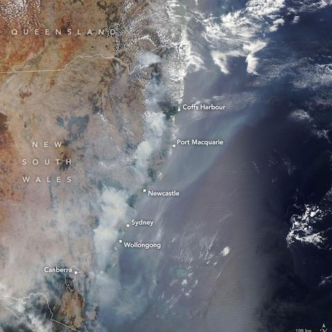 A handout photo made available by NASA Earth Observatory of a satellite image showing fires burning across New South Wales in December