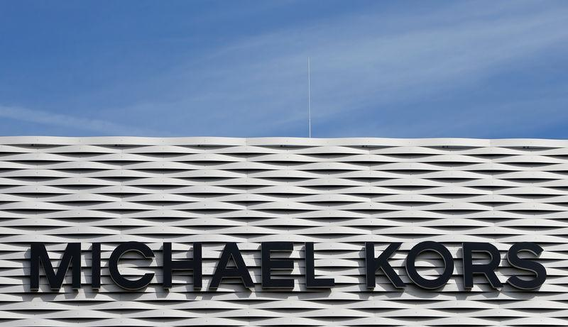 FILE PHOTO: The logo of Michael Kors is seen on an outlet store in Metzingen