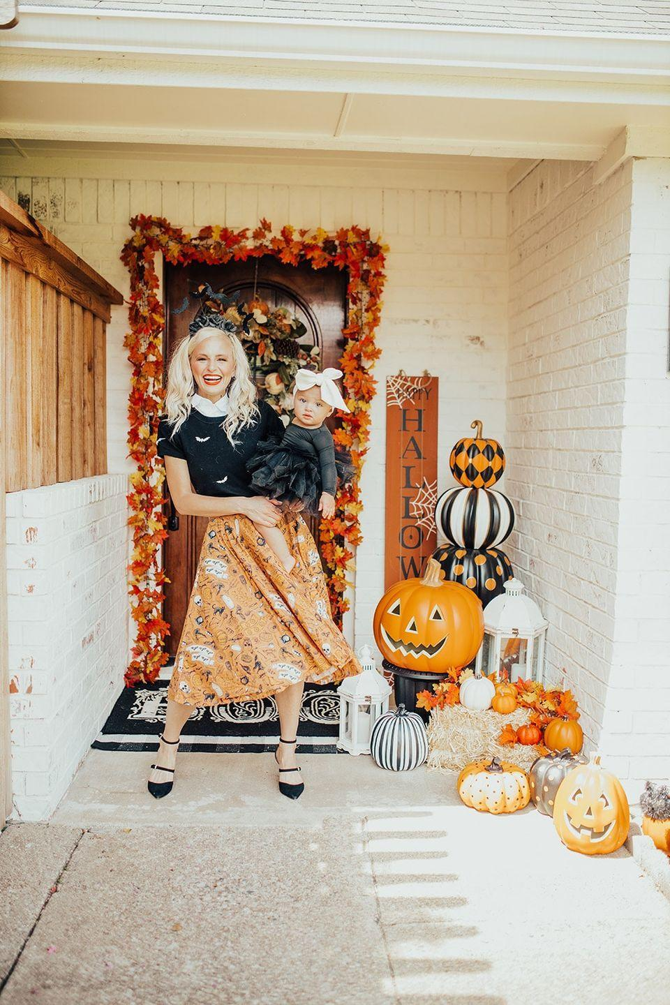 """<p>With a mix of sizes and prints, these cute pumpkins are giving us fun circus vibes. </p><p><strong>See more at <a href=""""https://vandifair.com/halloween-outdoor-decor/"""" rel=""""nofollow noopener"""" target=""""_blank"""" data-ylk=""""slk:Vandi Fair"""" class=""""link rapid-noclick-resp"""">Vandi Fair</a>. </strong></p><p><a class=""""link rapid-noclick-resp"""" href=""""https://go.redirectingat.com?id=74968X1596630&url=https%3A%2F%2Fwww.etsy.com%2Flisting%2F856349997%2Fhappy-halloween-porch-board&sref=https%3A%2F%2Fwww.thepioneerwoman.com%2Fhome-lifestyle%2Fdecorating-ideas%2Fg36877187%2Foutdoor-pumpkin-decorations%2F"""" rel=""""nofollow noopener"""" target=""""_blank"""" data-ylk=""""slk:SHOP HALLOWEEN SIGNS"""">SHOP HALLOWEEN SIGNS</a></p>"""
