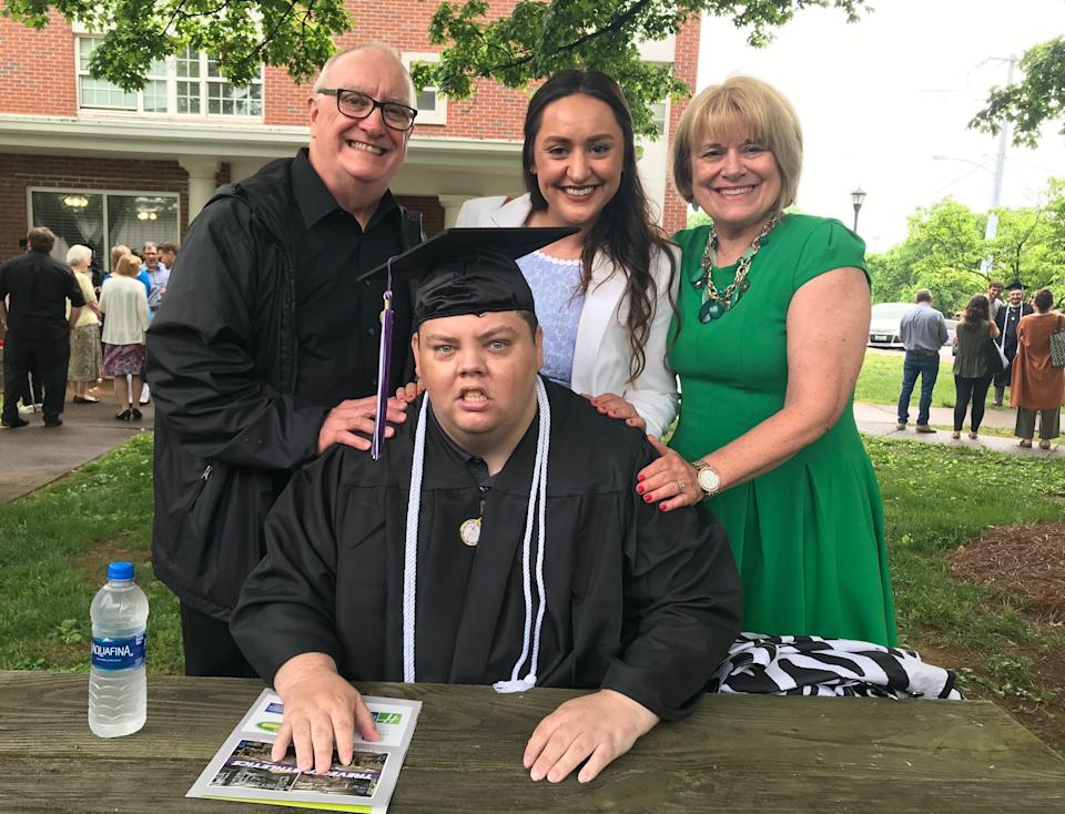 Brian Schnelle poses with his father, Jeff (left), his sister, Alex (center), and his mother, Jane (right), on graduation day. (CreditL Jane Schnelle)