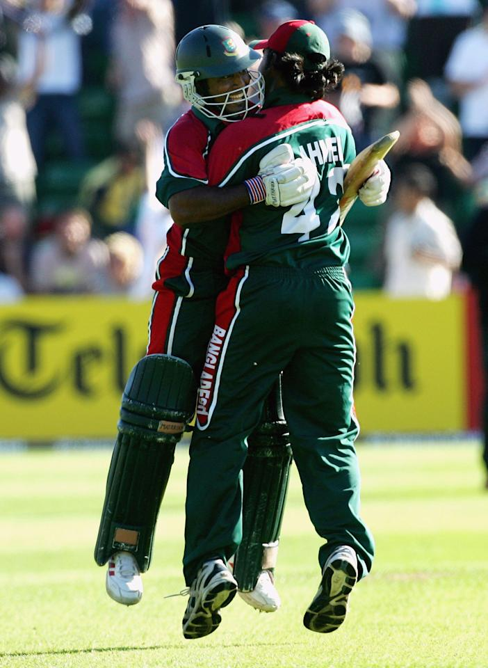 Aftab Ahmeb Chowdhury (left) and Shahriar Nafees of Bangladesh celebrate the winning run during the NatWest Series One Day International between Australia and Bangladesh played at Sophia Gardens on June 18, 2005 in Cardiff, United Kingdom  (Photo by Hamish Blair/Getty Images)