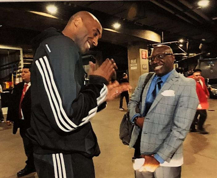 Lakers star Kobe Bryant and Times reporter Broderick Turner chat after Bryant's 60-point farewell game on April 13, 2016.