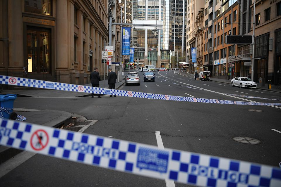 Police work at the scene of a fatal shooting on Bridge Street in the CBD. Source: AAP