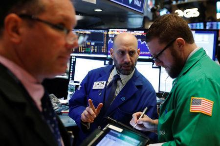 Traders work on the floor of the New York Stock Exchange shortly after the opening bell in New York, U.S., February 21, 2018.  REUTERS/Lucas Jackson