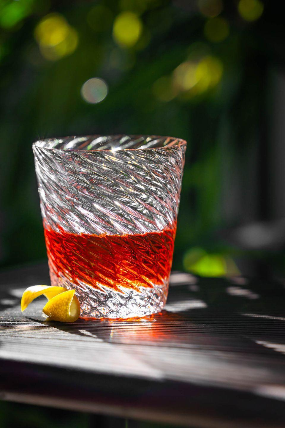 """<p>More than 180 years after it was first stirred up, the Sazerac is still one of NOLA's most popular drinks (not to mention <a href=""""https://www.nytimes.com/2008/07/16/dining/16pour.html"""" rel=""""nofollow noopener"""" target=""""_blank"""" data-ylk=""""slk:it's official cocktail"""" class=""""link rapid-noclick-resp"""">it's official cocktail</a>)—and it's easy to see why. Not only is the classic drink quite easy to make (all you need is rye whiskey, Peychaud's bitters, Angostura bitters, abstinthe, and a sugar cube), but it's also just about as stiff as they come.</p><p><a class=""""link rapid-noclick-resp"""" href=""""http://www.gastronomista.com/2014/05/trust-me-youre-drinking-your-sazerac.html#.YAn0i5NKg6i"""" rel=""""nofollow noopener"""" target=""""_blank"""" data-ylk=""""slk:GET THE RECIPE"""">GET THE RECIPE</a><br></p>"""