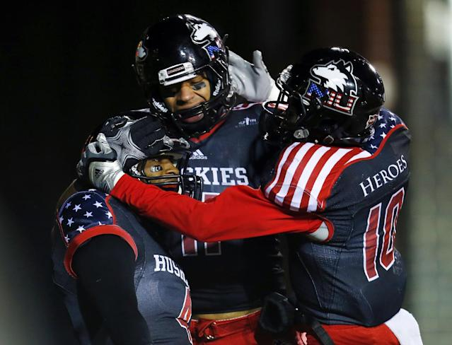 Northern Illinois wide receiver Da'Ron Brown (4) celebrates with teammates Juwan Brescacin (11) and Tommylee Lewis (10) after a touchdown reception against Ball State during the first half of an NCAA college football game Wednesday, Nov. 13, 2013, in DeKalb, Ill. (AP Photo/Jeff Haynes)