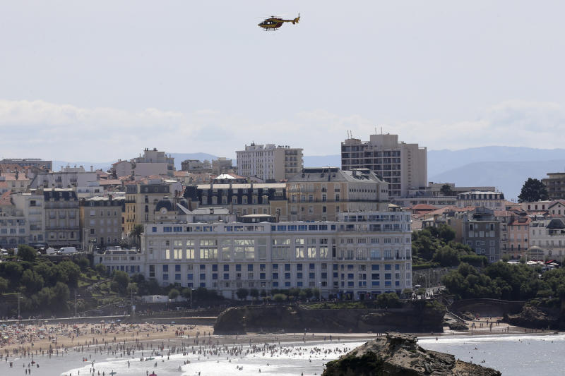 A security helicopter flies over the G7 summit venue Casino Bellevue, Wednesday, Aug. 21, 2019 in Biarritz, southwestern France. Leaders of the Group of Seven nations will meet Saturday for three days in the southwestern French resort town of Biarritz. France holds the 2019 presidency of the G-7, which besides the U.S. also includes Britain, Canada, Germany, Italy and Japan. (AP Photo/Bob Edme)
