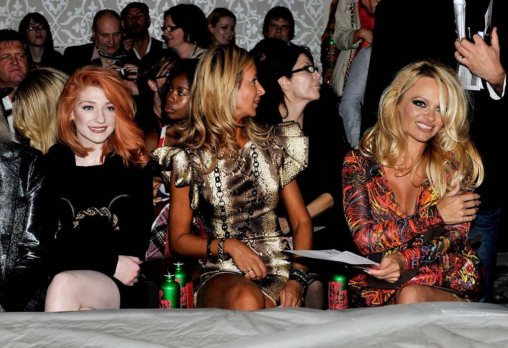 "Pamela sat front row at the show along with British pop star Nicola Roberts (far left) and Lady Victoria Hervey. Gareth Cattermole/<a href=""http://www.gettyimages.com/"" target=""new"">GettyImages.com</a> - September 19, 2010"