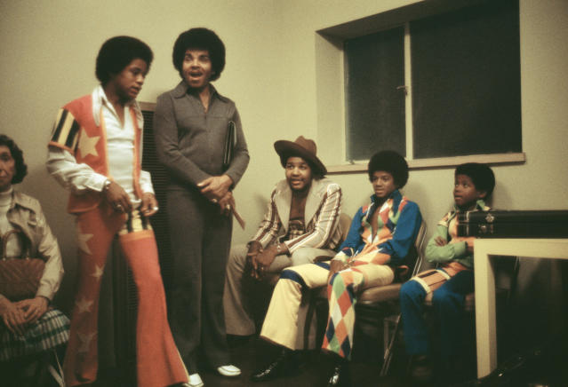 Michael Jackson with brothers Randy and Marlon and their father, Joe, backstage at the Inglewood Forum in 1973. (Photo: Michael Ochs Archives/Getty Images)