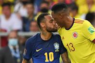 Brazil's Neymar (left) and Colombia's Yerry Mina were in close proximity throughout much of the teams' World Cup qualifier (AFP/JUAN BARRETO)
