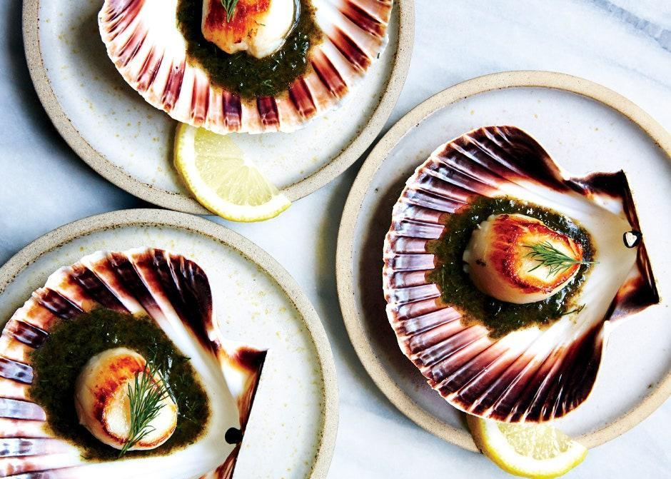 """These seared scallops on the half shell make for a show-stopping presentation. If your fishmonger can't order the shells for you, use small plates. <a href=""""https://www.bonappetit.com/recipe/scallops-with-nori-brown-butter-and-dill?mbid=synd_yahoo_rss"""" rel=""""nofollow noopener"""" target=""""_blank"""" data-ylk=""""slk:See recipe."""" class=""""link rapid-noclick-resp"""">See recipe.</a>"""