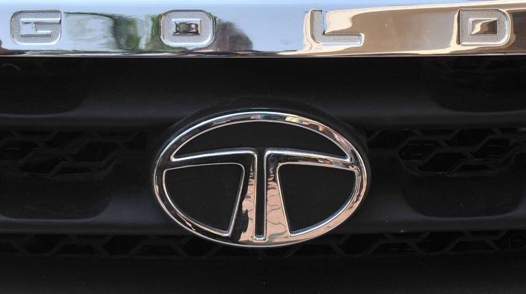 A Tata Motors logo is pictured on the front of a Tata Sumo Gold car