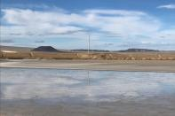 FILE PHOTO: One of Albemarle's lithium evaporation ponds reflects the sky at its facility in Silver Peak