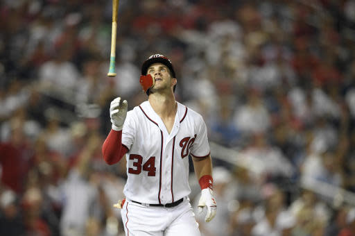 Washington Nationals' Bryce Harper reacts after he grounded out during the seventh inning of a baseball game against the New York Yankees, Monday, June 18, 2018, in Washington. The Yankees won 4-2. (AP Photo/Nick Wass)