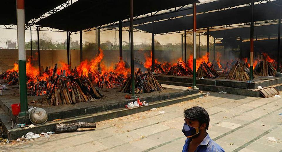Funeral pyres of those who died from the coronavirus during a mass cremation in New Delhi. (Reuters)