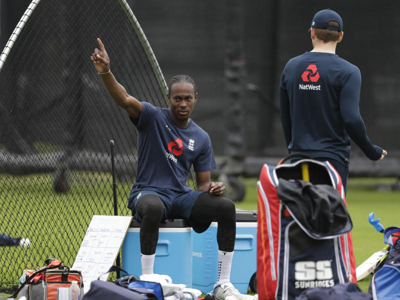 England's Jofra Archer, left, points as he speaks to England's captain Eoin Morgan at Lord's cricket ground in London, Monday, June 24, 2019. England willplay Australia in a World Cup cricket match at Lord's on Tuesday. (AP Photo/Kirsty Wigglesworth)