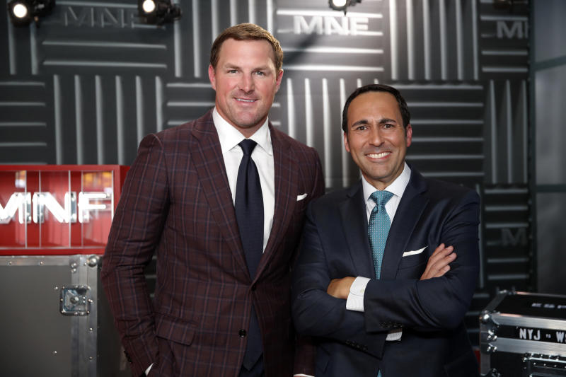 """In this Thursday, Aug. 16, 2018, file photo, former NFL player and now analyst Jason Witten, left, and play-by-play commentator Joe Tessitore pose for a photograph before their ESPN telecast of a preseason NFL football game between the Washington Redskins and the New York Jets in Landover, Md. Witten holds one of the most prominent television jobs in the sport as the lead analyst for Monday Night Football."""" Witten is approaching his new role in similar fashion as he did his old one when his comprehensive film work made him the second most productive tight end in NFL history. (AP Photo/Alex Brandon, File)"""