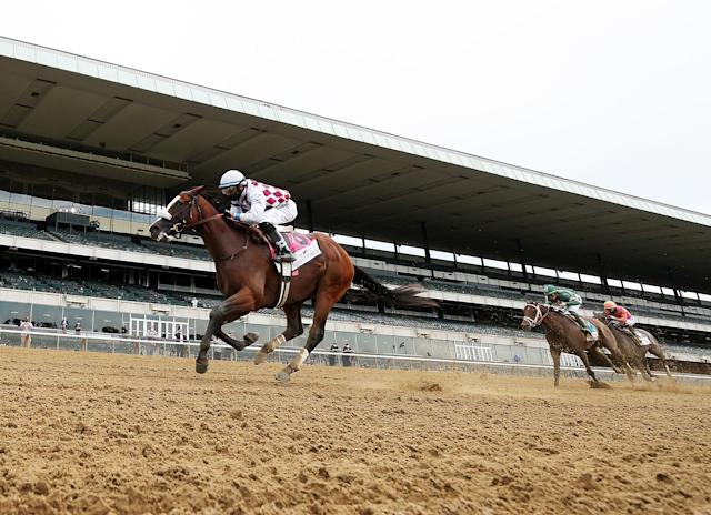 Jockey Manuel Franco rides atop Tiz the Law after crossing the finish line to win the 152nd running of the Belmont Stakes at Belmont Park on June 20, 2020, in Elmont, New York. (Al Bello/Getty Images)