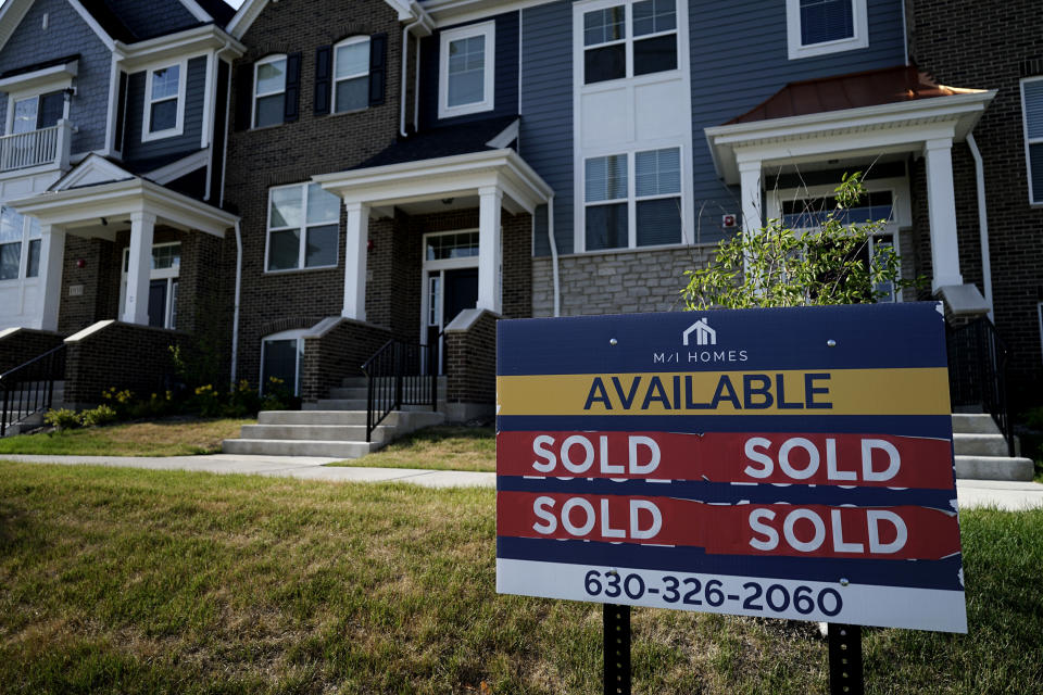 A building land advertising sign stands in front of a new home construction site in Northbrook, Illinois on Wednesday June 23, 2021 as the housing market recovers and mortgage rates remain low.  (AP Photo / Nam Y. Huh)