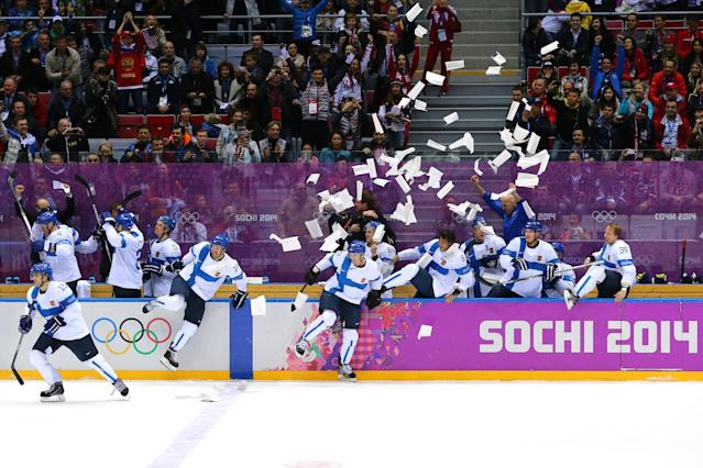 SOCHI, RUSSIA - FEBRUARY 22: Finland celebrate after defeating the United States 5-0 during the Men's Ice Hockey Bronze Medal Game on Day 15 of the 2014 Sochi Winter Olympics at Bolshoy Ice Dome on February 22, 2014 in Sochi, Russia. (Photo by Bruce Bennett/Getty Images)