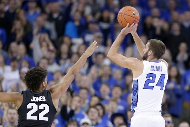 Creighton's MitchBallock (24) shoots for three over Gonzaga's Jeremy Jones (22) during the first half of an NCAA college basketball game in Omaha, Neb., Saturday, Dec. 1, 2018. (AP Photo/Nati Harnik)