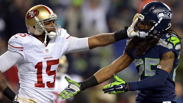 Michael Crabtree shoves Richard Sherman toward the end of the 2013 NFC Championship Game