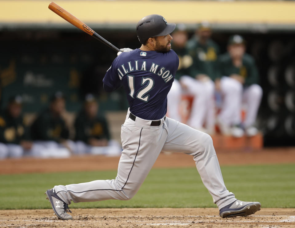 Seattle Mariners' Mac Williamson swings for an RBI-groundout off Oakland Athletics' Frankie Montas in the second inning of a baseball game Saturday, June 15, 2019, in Oakland, Calif. (AP Photo/Ben Margot)