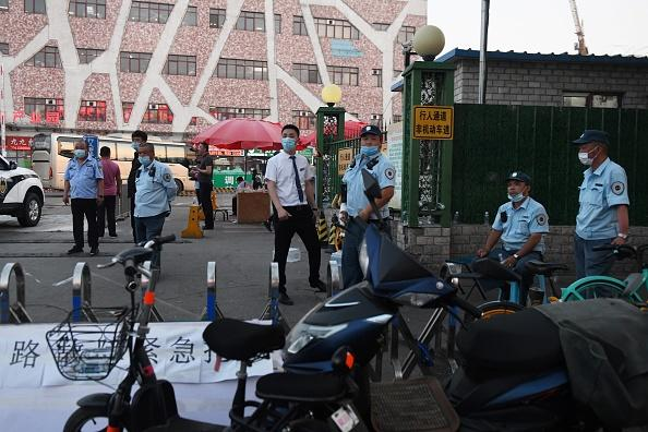 Chinese police block the entrance of the Xinfadi meat wholesale market in Beijing.