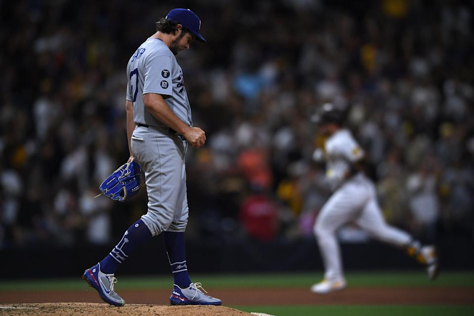 Los Angeles Dodgers starting pitcher Trevor Bauer (left) looks on from the mound after a home run by San Diego Padres catcher Victor Caratini (right) during the seventh inning at Petco Park.