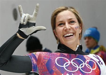 Noelle Pikus-Pace of the U.S. reacts after competing in the women's skeleton event at the 2014 Sochi Winter Olympics, at the Sanki Sliding Center in Rosa Khutor February 14, 2014. REUTERS/Arnd Wiegmann