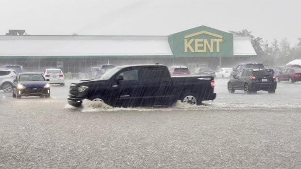 A pickup truck is shown driving through the storm in Windsor, N.S. (Robert Short/CBC - image credit)