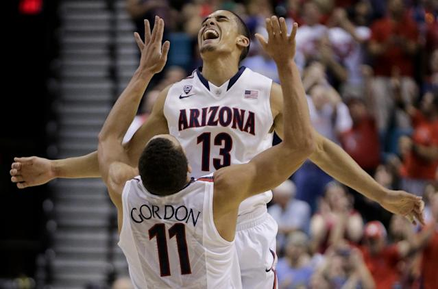 Arizona's Nick Johnson (13) reacts with Aaron Gordon after hitting a 3-point basket against Colorado during the first half of an NCAA college basketball game in the semifinals of the Pac-12 Conference on Friday, March 14, 2014, in Las Vegas. (AP Photo/Julie Jacobson)
