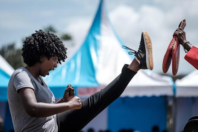 <p>A woman performs taekwondo during the ceremony of the International Women's Day at Kawangware in Nairobi on March 8, 2018. (Photo: Yasuyoshi Chiba/AFP/Getty Images) </p>