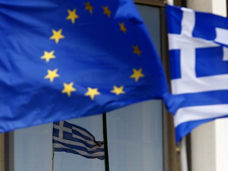 EU and Greek flags are seen outside Greece's Foreign Ministry in Athens