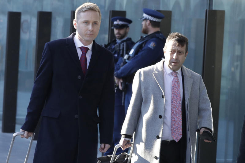 FILE - In this Aug. 15, 2019, file photo, Jonathan Hudson, left, and Shane Tait, defense lawyers for Brenton Tarrant, arrive at the Christchurch District Court in Christchurch, New Zealand. Tarrant who has admitting killing 51 worshippers in a mass shooting at two mosques in Christchurch on March 15, 2019 has dismissed his legal team and will represent himself at a sentencing hearing next month. Tarrant's sentencing hearing, delayed by the coronavirus pandemic, will begin in Christchurch on Aug. 24, 2020 and could last more than three days.  (AP Photo/Mark Baker, File)