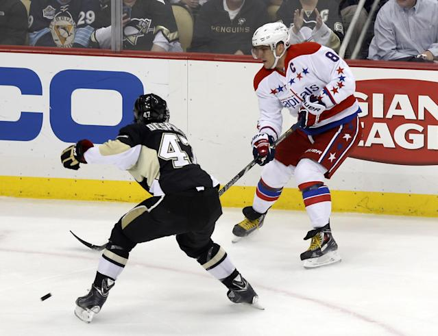 Washington Capitals' Alex Ovechkin (8), of Russia, passes past Pittsburgh Penguins' Simon Despres (47) during the first period of an NHL hockey game, Tuesday, March 11, 2014, in Pittsburgh. (AP Photo/Keith Srakocic)