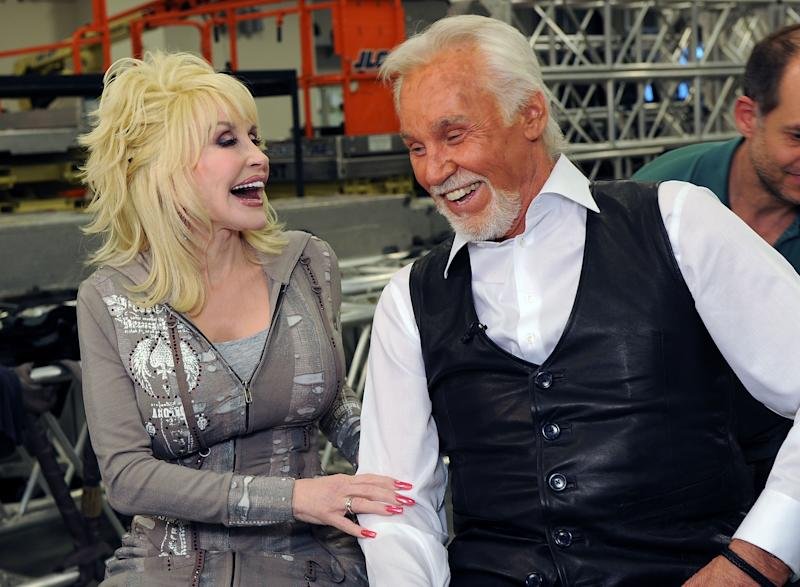 Country music star Dolly Parton honored fellow musician Kenny Rogers, who died at age 81, with a video tribute. (Photo: Rick Diamond/Getty Images)