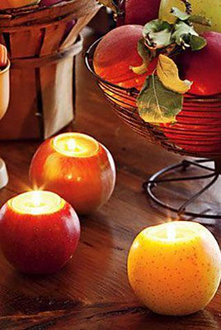 """<p>Not only do these apple candleholders create a party ambiance, but you can also use them all fall for any special dinners you may have planned. </p><p><em><strong><a href=""""https://www.womansday.com/home/crafts-projects/how-to/a5284/halloween-decoration-apple-candleholders-how-to-110913/"""" rel=""""nofollow noopener"""" target=""""_blank"""" data-ylk=""""slk:Get the Apple Candleholders tutorial."""" class=""""link rapid-noclick-resp"""">Get the Apple Candleholders tutorial.</a></strong></em></p>"""
