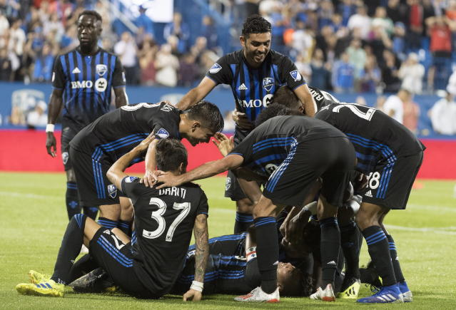 Montreal Impact players celebrate a goal by Orji Okwonkwo against the Portland Timbers during the second half of an MLS soccer match in Montreal, Wednesday, June 26, 2019. (Graham Hughes/The Canadian Press via AP)
