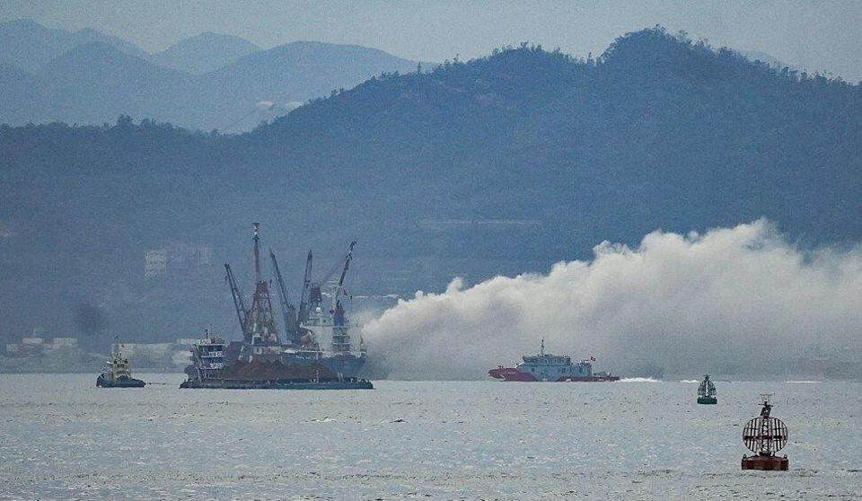The boat, carrying 2,000 tonnes of metallic waste, burst into flames in Victoria Harbour just before 5.30pm on Wednesday. Photo: Felix Wong