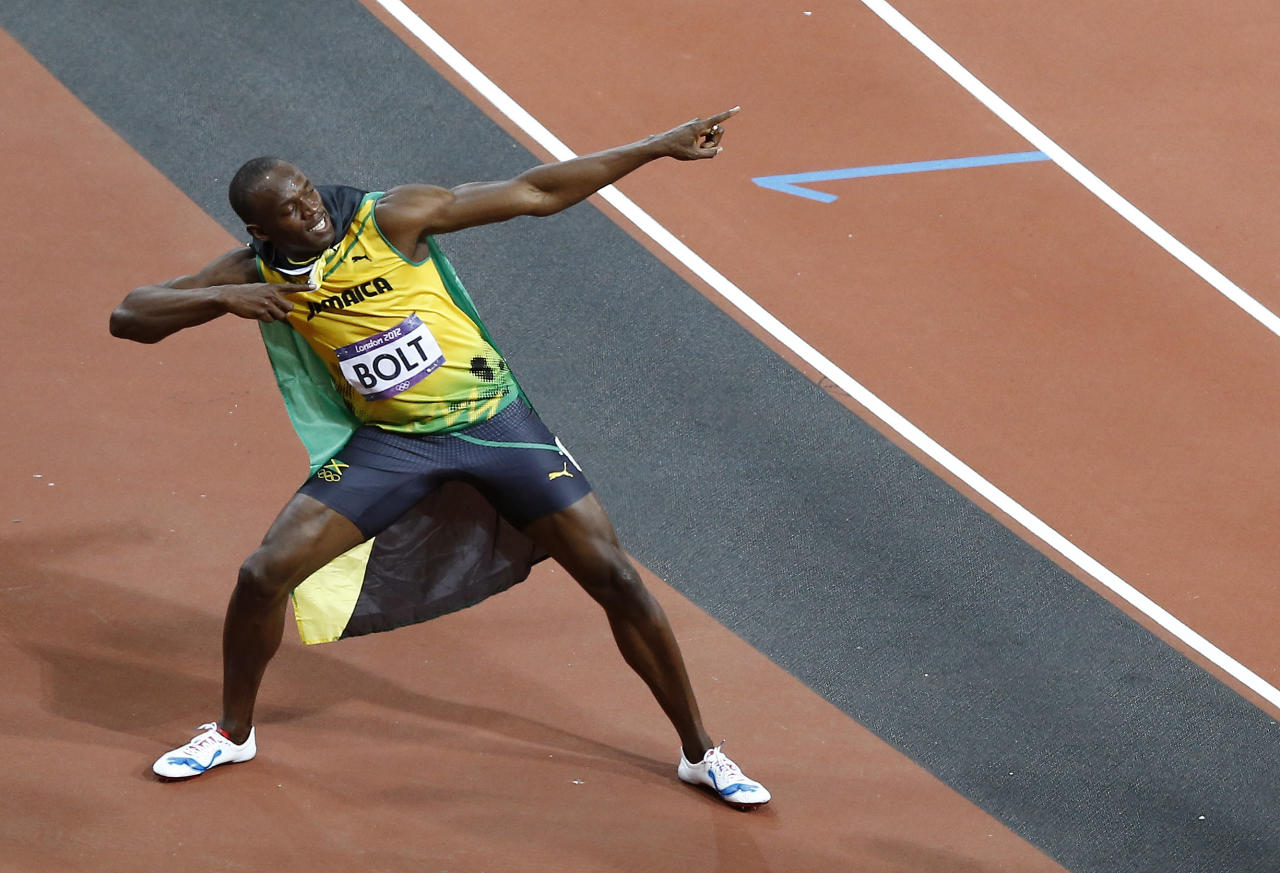 Jamaica's Usain Bolt celebrates winning gold in the men's 100-meter final during the athletics in the Olympic Stadium at the 2012 Summer Olympics, London, Sunday, Aug. 5, 2012. (AP Photo/Daniel Ochoa De Olza)