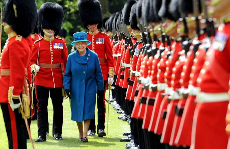 Buckingham Palace have become embroiled in a racism row. She's pictured here with the Grenadier Guards. Photo: Getty Images