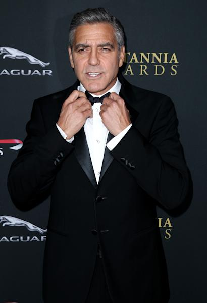 George Clooney arrives at the 2013 BAFTA Los Angeles Britannia Awards at the Beverly Hilton Hotel on Saturday, Nov. 9, 2013 in Beverly Hills, Calif. (Photo by Matt Sayles/Invision/AP)