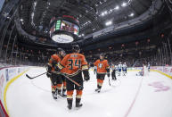 Anaheim Ducks' Devin Shore (29), Sam Steel (34) and Rickard Rakell (67), of Sweden, celebrate Steel's goal against the Vancouver Canucks during the third period of an NHL hockey game Sunday, Feb. 16, 2020, in Vancouver, British Columbia. (Darryl Dyck/The Canadian Press via AP)