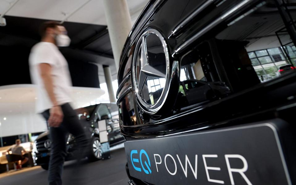 A visitor passes an EQA Power all-electric automobile in a Mercedes Benz AG dealership in Berlin, Germany - Liesa Johannssen-Koppitz/Bloomberg