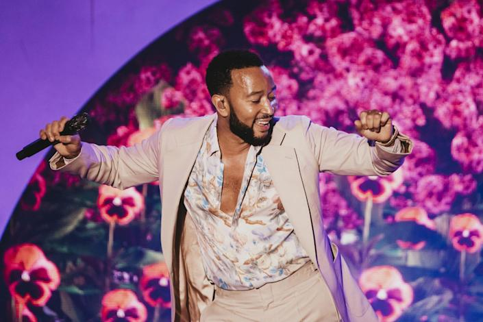 <p>John Legend gets down on Sept. 21 during his show at L.A.'s Greek Theatre. </p>