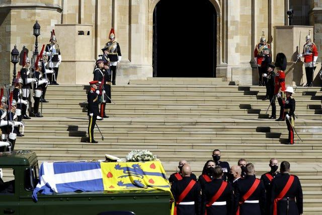 The Duke of Edinburgh's coffin, covered with His Royal Highness's Personal Standard, on the Land Rover Defender outside St George's Chapel, Windsor Castle, Berkshire