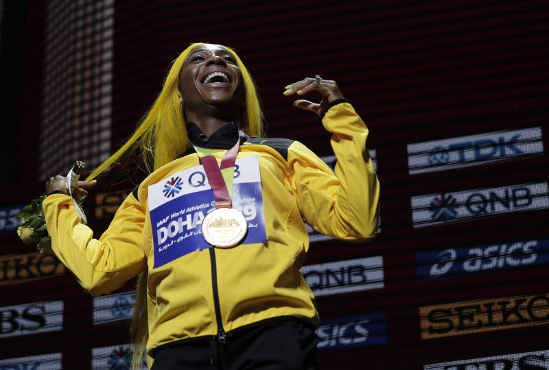 Shelly-Ann Fraser-Pryce of Jamaica, gold medalist in the women's 100 meters, reacts during the medal ceremony at the World Athletics Championships in Doha, Qatar, Monday, Sept. 30, 2019. (AP Photo/Nariman El-Mofty)