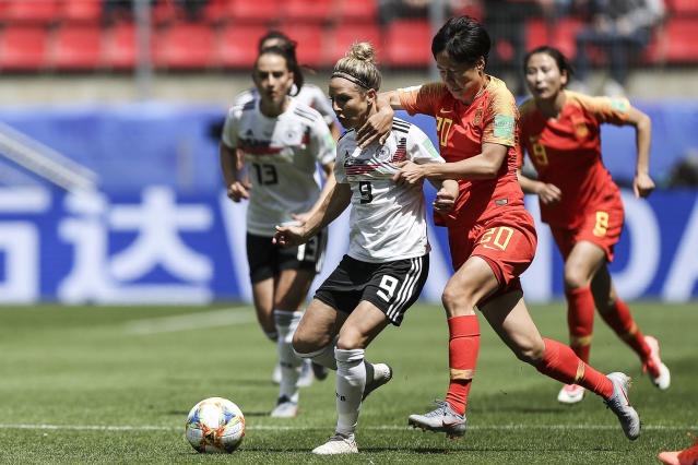 Svenja Huth of Germany battle for possession with Rui Zhang of China during the 2019 FIFA Women's World Cup France group B match between Germany and China PR at Roazhon Park on June 08, 2019 in Rennes, France. (Photo by Maja Hitij/Getty Images)