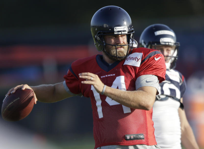 Houston Texans quarterback Ryan Fitzpatrick (14) prepares to throw a pass during NFL football training camp Monday, July 28, 2014, in Houston. The Texans signed Fitzpatrick in the offseason hoping the veteran will help turn around an offense that did very little right last year. (AP Photo/Pat Sullivan)